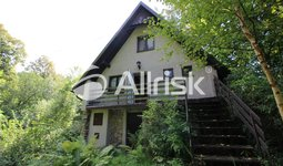 Zděná chata v klidné části Holčovic