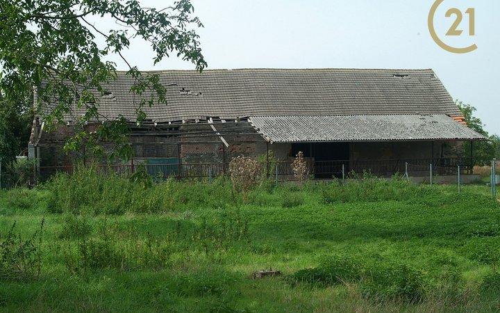 Stavební pozemek  2 406 m², okres Kolín