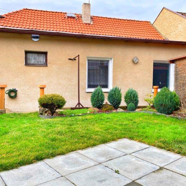 Krásný rodinný dům 3+1 s garáží a zahrádkou v centru Slaného