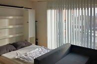 Pokoj s rozloženou postelí