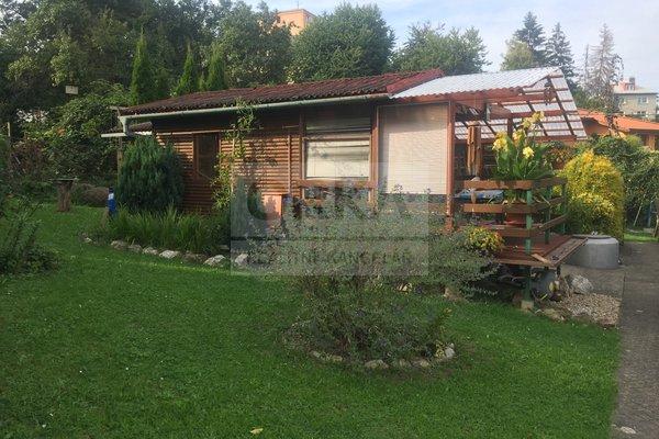 Prodej stavebního pozemku s chatkou a garáží, 908m² - Zábřeh, ul. Nemilská