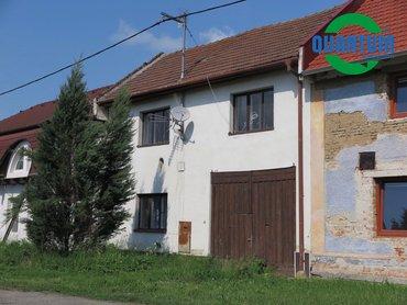 Prodej rodinného domu 4+1 se zahradou v obci Prasklice