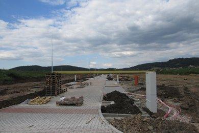 Prodej stavebního pozemku Tišnov, nová ulice, Ev.č.: 00125