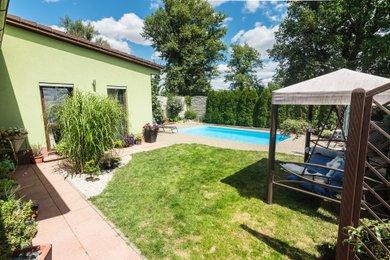 Prodej nízkoenergetického RD 5+kk s garáží a bazénem v Hrušovanech u Brna, Ev.č.: 000758