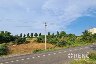 Prodej stavebního pozemku v Žebětíně o velikosti 1735 m2 na okraji obce se stavebním povolením pro výstavbu provozovny či RD, Ev.č.: 00785-1